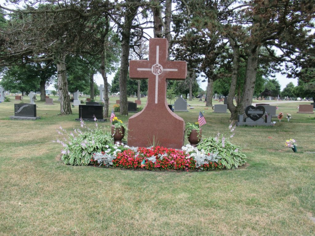 Grave cross with flowers