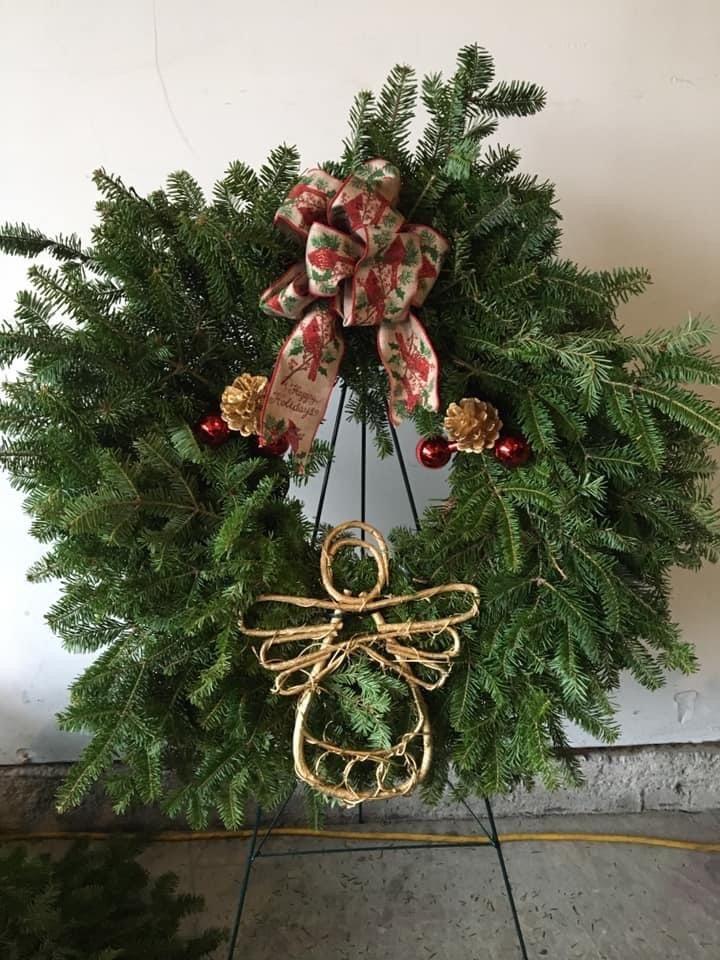 Wreath with decorative angel.