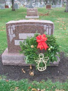 Wreath on gravestone.