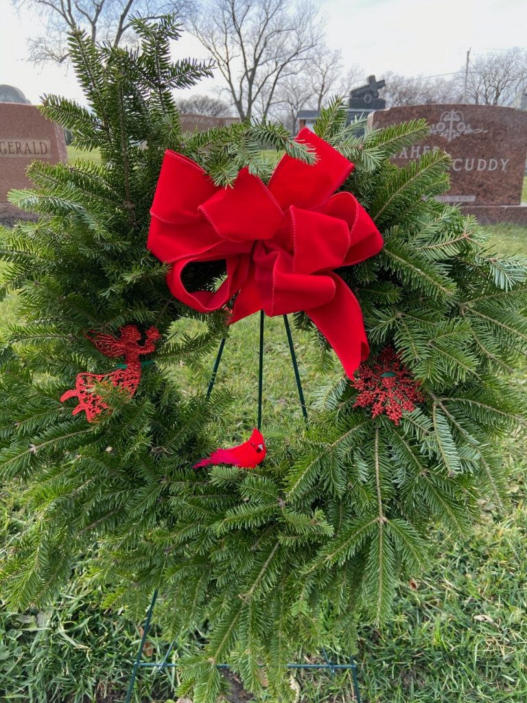 Christmas wreath with red bow and bird.