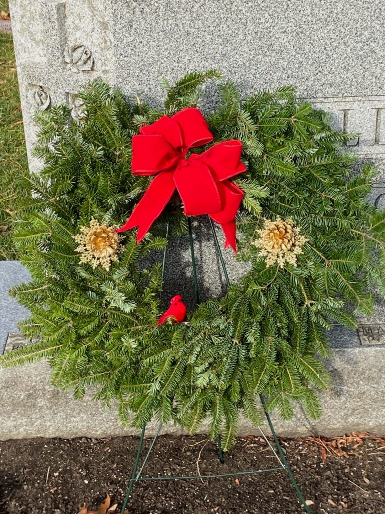 Wreath with a red bow.